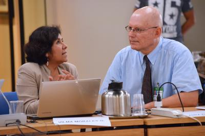 Vilma Morales Quillama, Peru, speaks to Joe DiGangi, IPEN Senior Advisor. Photo by Earth Negotiations Bulletin.