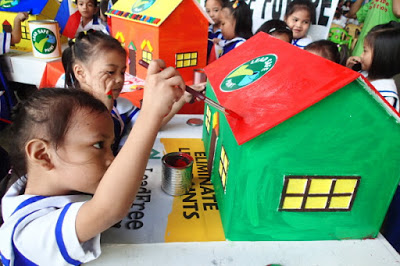 Children paint houses at EcoWaste Coalition's awareness-raising program
