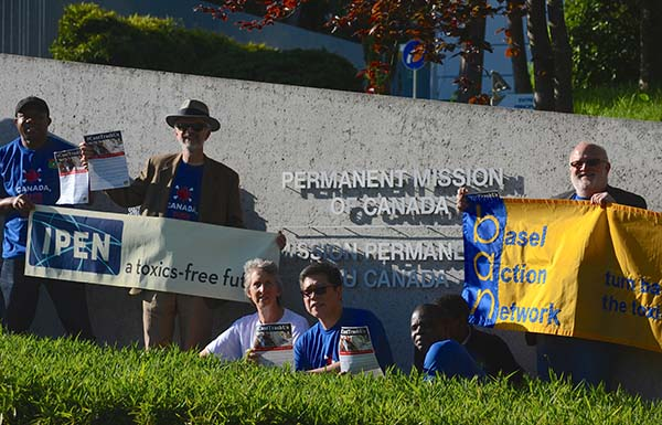 Activists attending the Basel Convention in Geneva protest in front of Canadian Embassy.