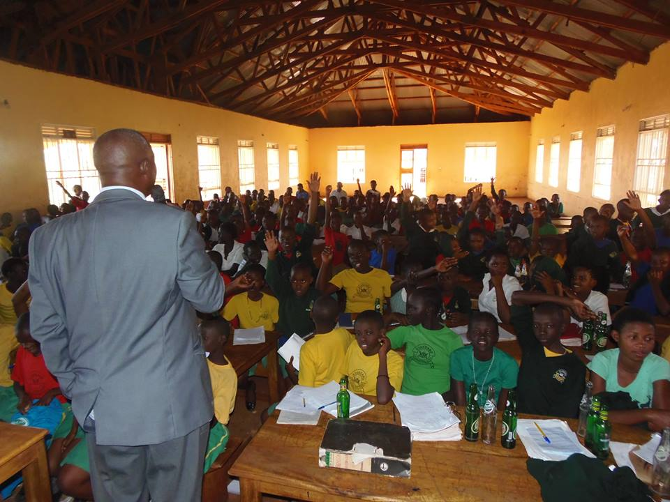 Geoffrey Kamese educating kids at Standard Junior Primary School located in Zaana, Kampala City about lead hazards