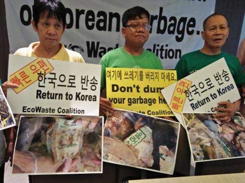 BACK TO KOREA: Green activists from Buklod Tao and the EcoWaste Coalition laud impending re-exportation of garbage imported from South Korea this January, as confirmed by the Bureau of Customs, as a victory for environmental justice.