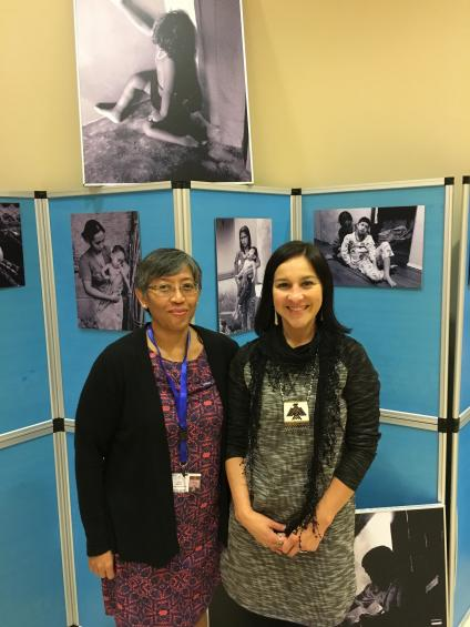 Yuyun Ismawati (BaliFokus) and Rochelle Driver (IITC) in front of the BaliFokus photo exhibit