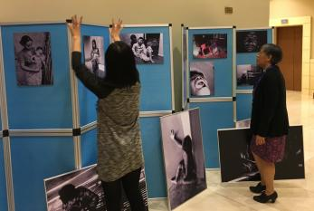 Rochelle Diver and Yuyun Ismawati setting up photo exhibit