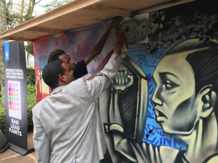 Tadesse Amera painting the mural at UNEA2