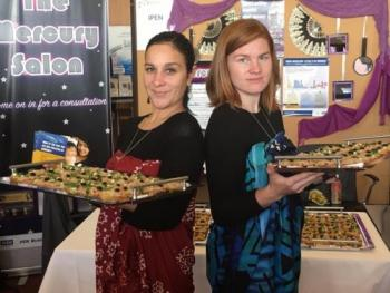 Rochelle Diver (IITC) and Emily Boone (IPEN) serve tuna fish snacks to raise awareness about high mercury levels in fish.