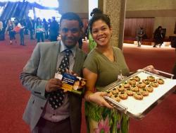 Tadesse Amera (PAN-Ethiopia) and Tiffany Tool (IPEN) serve tuna fish snacks at Mercury Treaty COP1.