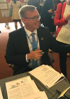 Ado Lõhmus, Deputy Secretary General, Ministry of Environment (Estonia) signing a consent form for hair testing at the IPEN booth