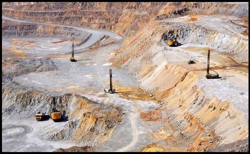 Dexing is Asia's largest open pit copper mine – note the full sized digger machines and dump truck