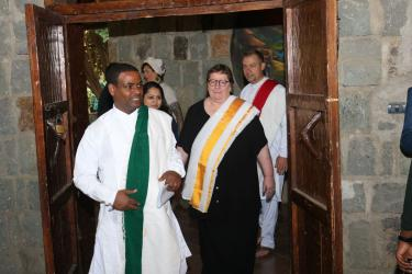 IPEN Co-Chairs Tadesse Amera and Pamela Miller, followed by IPEN International Coordinator Bjorn Beeler, enter in Ethiopian ceremonial dress to open the Global Meeting.