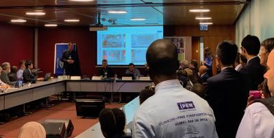 Lars Ystanes (Equinor environmental advisor) speaking at the standing-room-only side event, with an IPEN supporter in the foreground