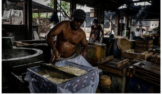 A commercial tofu kitchen in Tropodo, Indonesia. The tofu is processed in boilers fueled by burning plastic.Credit...Ulet Ifansasti for The New York Times
